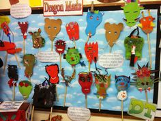 This display was made as part of a unit of work on dragons and film-making. The children planned, designed and made their own masks which were later used in a film about dragons! Dragon Knight, Knight Art, Dragon Mask, Red Dragon, Do Dragons Exist, Knights And Castles Topic, Castle Classroom, Dragon Facts, Fairy Tales Unit