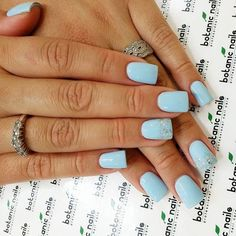 Pale blue with a pale blue and glitter accent nail