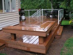 Small Wooden Deck Idea | Glossy wood deck with wood bench and black table and chairs