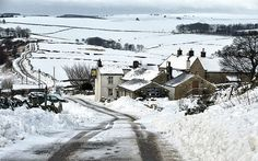 The Barrel Inn in Bretton, Derbyshire, nestles in a snowy landscape