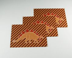 A set of 3 postcards for the christmas holidays. This funny dinosaur will make all your friends and family happy. This stegosaurus is printed on 250