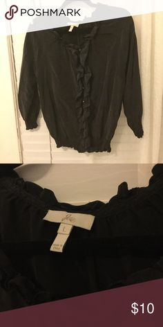 Joie black silk top blouse size L Beautiful black ruffled Joie blouse. No holes or stains, gently used condition. Really cute for work or with jeans and heels! Joie Tops Blouses