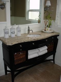 LOVE this vanity! We salvaged an old wine buffet from a second hand store, had granite cut to fit the serpentine top and repurposed it for the bathroom.