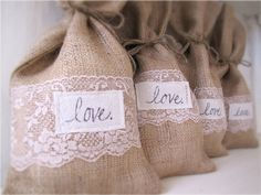Adorable burlap bag favor bags wrapped in a band of lace