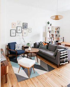 Scandinavian living room with white walls, grey sofa and danish furniture