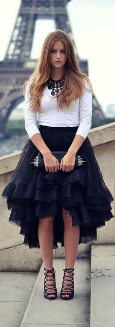 Women's fashion | White 3/4 sleeve top, black ruffled skirt and heels, clutch, statement necklace
