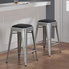 Add a modern look to your counter with these Tabouret stools. A bonded leather padding and scratch and mark resistant finish completes this set of two stools.