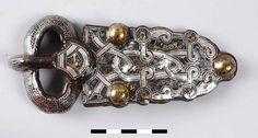 """Belt parts of a 7th century Frankish warrior. Found in Lent, the Netherlands. Silver, iron, and brass."""
