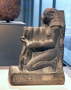 Kneeling Statue of Senenmut, Chief Steward of Queen Hatshepsut. Date c. 1473-1458 B.C. Medium sculpture on gray green schist. Temple of Montu, Armant, Egypt, New Kingdom, Dynasty 18. Kimbell Art Museum, Fort Worth, Texas.