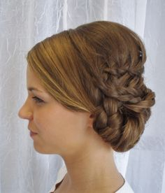 Our stylist, Mackenzie, created this braided updo for one of our bridal clients during a recent hair trial run. www.euphoriaspalon.com