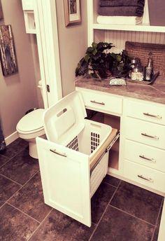 Smart idea keeps hamper hidden.. Good for putting towels in the hamper