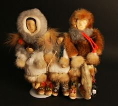 Hand Crafted Doll Family This handcrafted family of dolls was created by Susie Brown. The heads are carved from willow, and the furs consist of seal, rabbit, muskrat, wolf and mink. They measure 10 inches tall and 9.5 inches across. Susie is a Yupik Eskimo from Eek, Alaska and is deceased.  This is a rare find.
