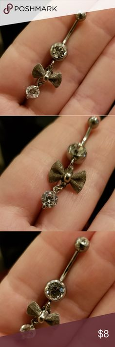NWOT Silver drop bow and stone belly button ring NWOT never worn. Received as a gift and has sat in my jewelry box.  Silver drop belly button ring with silver mesh bow This piece is sanitized for good measure and ready to be shipped to it's new home.   Purchased from hot topic, this is not an expensive piece, I cannot guarantee it's longevity however it is extremely cute and if you care for it properly it may last a while.   Please feel free to ask questions, don't forget to bundle and save…