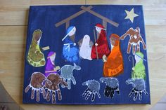 Nativity made with handprints and footprints. Tissue paper clothes.