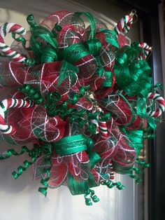 Red and Green Deco Mesh Wreath with Green Metallic Ribbon, Christmas Wreaths, Mesh Wreaths, Door Decor. $75.00, via Etsy.