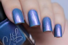Buh Buh Buh Buh Buh - Periwinkle blue jelly base with intense violet shimmer and micro flake.  This polish glows and the color differs in different lighting and hand movement. Swatch by @de_briz on Instagram.