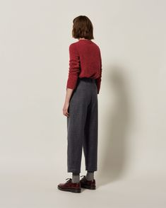 CHECK WOOL TROUSER   Smooth, wool blend mini-gingham, woven in Britain. Ankle-skimming, tapered leg. Two pleats just below front waistband. Belt loops. Hook and bar fastening. Back welt pocket. Side pockets.
