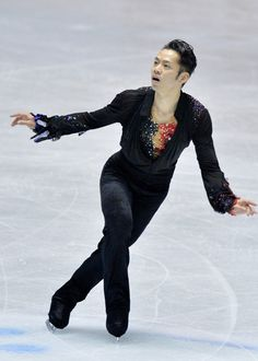 Daisuke Takahashi Photos Photos - Daisuke Takahashi of Japan competes in the free program during day two of the ISU World Team Trophy at Yoyogi National Gymnasium on April 12, 2013 in Tokyo, Japan. - ISU World Team Trophy: Day 2
