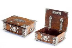 """SEVENTEENTH CENTURY CEYLON JEWELRY BOX Portuguese model from the 17th century. Teak with engraved and chiselled silver applications. Lock frame decorated with the eagles of Kandy (the capital of the extinct """"Kingdom of the Mountains"""" in Ceylon. Small defaults. Apochryphal key. Dim.: 6 x 11 x 15 cm.See: """"A História de D. João de Kandia"""" (Ceylon circa 1578 - Lisbon 1642 Wooden Art Box, Wood Boxes, Wood Box Design, Indian Furniture, Dutch Colonial, Antique Boxes, Casket, Box Art, 17th Century"""