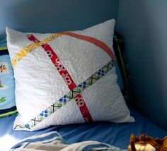 What a cute pillow, to go with a nice quilt!  Check this site out, some nice tutorials, and they are free!