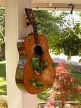 Guitar Planter! *cough cough* @Jenkins. This would look awesome at the farm :)