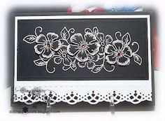 white embossing on black with flowers fussy cut and on dimensionals...very pretty and lacey effect...