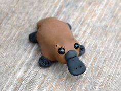 Tiny platypus Handmade miniature polymer clay by AnimalitoClay, $20.00