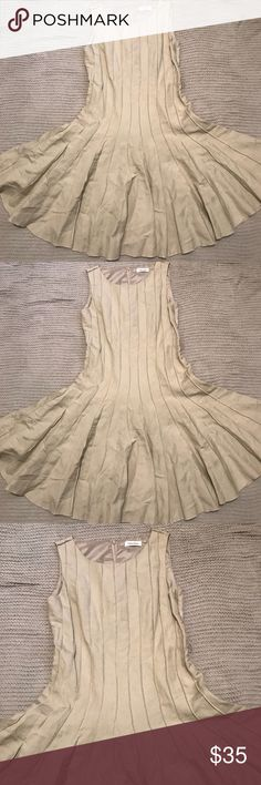 Calvin Klein Dress Cute Calvin Klein Dress, khaki colored.  Has small belt loops for belt if you want to wear one with it.  Pleated Skirt.   Super cute dress! Calvin Klein Dresses Midi