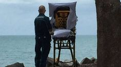 """The moment was captured in a photograph and shared on Facebook by the Queensland Ambulance Service.  """"A crew were transporting a patient to the palliative care unit of the local hospital and the patient expressed that she just wished she could be at the beach again,"""" reads the post's caption"""