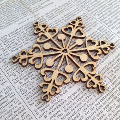 Whimsical LaserCut Wood Snowflake Ornament by tomiannie on Etsy, $3.50