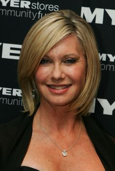 Short Hairstyles Lookbook: Olivia Newton-John wearing Bob (11 of 14). Olivia looks chic in a blond bob with side swept bangs.