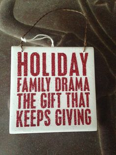 "No holiday is complete without a little family drama! This plaque measures 3.5"" x 3.5"", with a wire hanger, making this perfect to hang or tie on a package."