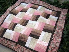 Cute split rail fence quilt....love that the border has the pattern while the squares pull from its colors.