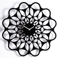 Black+and+Black+Clock+by+Diamantini+-+The+Black+&+Black+Clock+by+Diamantini+creates+a+dramatic+silhouette+on+any+wall.+With+symmetrical+lines+and+cut+outs,+this+clock+is+almost+floral+in+its+appearance.+This+contemporary+wall+clock+features+a+bold+geometric+pattern+and+a+creative+design+which+results+in+a+stunning+timepiece.+The+Black+&+Black+Clock+is+constructed+of+two+powder-coated+steel+segments.+The+smaller+segment+rests+on+top+of+the+larger+section.+This+creates+a+three+dimensio...