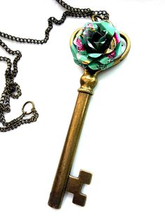 This unique eco friendly fashion necklace is made with a brass key pendant and a recycled Arizona Tea flower. Choose chain length at checkout. Key measures 3 7/8""
