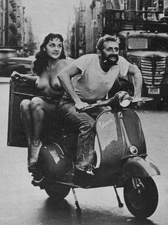The Nymph has long desired a Vespa. But I don't think she intends to ride (or drive) it like this.    Picture dates from 1960, in Jerry Yulsman Tells How to Take Glamour Photos.