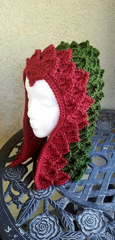 This Dragon Hood is fun to create with the Crocodile Stitch. Make your fantasy dragon hood in any colors imaginable! Takes approximately a skein and a half to make I used Red Heart with love in the Green and Caron Simply Soft in the red.