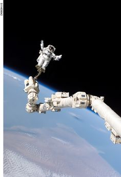 Astronaut Stephen K. Robinson on ISS Canadaarm2  3 August 2005, Astronaut Stephen K. Robinson, STS-114 mission specialist, anchored to a foot restraint on the International Space Station's Canadarm2, participates in the mission's third session of extravehicular activity (EVA). The blackness of space and Earth's horizon form the backdrop for the image.Spacewalks – Blue Sky: credit: NASA