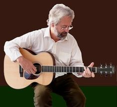 Free music, tablatures, chords and videos for guitar, tenor guitar and mandolin players.