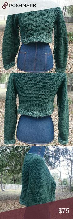 """Hand Knit Green Crop Loose Knit Pullover Stretchy loose knit & comfy! Hand knit & designed by me. Knit in soft dark green 100% acrylic yarn, trimmed in soft fuzzy multi green on the sleeves, bottom hem, around the neck & along the underarm seam. Front has diagonal design. Measures 19"""" across front bust from underarm to underarm, neck opening 22"""", length from shoulder to bottom hem 13"""", sleeves 19"""" from shoulder edge. This will fit up to L depending on how loose you like your sweaters. Color…"""