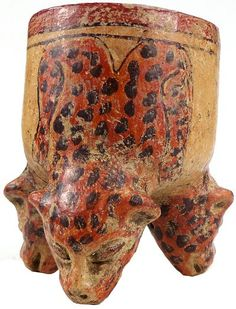 Mayan Culture Pottery :    Three-footed terracotta vessel, the feet in the shape of cheetah heads. Traces of red, brown, and orange.  600-900 AD