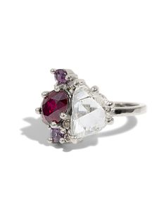 This custom made Diamond Cluster Ring features a Pigeon's Blood ruby and a high clarity free form Australian rose cut diamond. Shown in high polish 14kt white gold with no rhodium plating with a hammered shank.