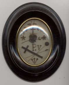 Touching hairwork on glass. It is unusual to find hairwork pictures with a heart and/or a cross.
