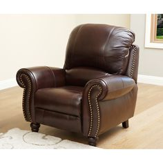 Upholstered in premium-grade, top-grain leather and featuring brass stud trim, the Madison leather reclining armchair is both chic and comfortable. This leather armchair is operated through a manual push-back reclining function.