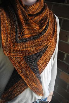 Flamboyan is an elegant triangular shawl composed of garter and stockinette stitch along with a ribbed edge. Basic intarsia techniques are utilized to achieve a block of color in the center of the shawl. Choose your favorite color combination and luxuriate in this special piece of knitwear!