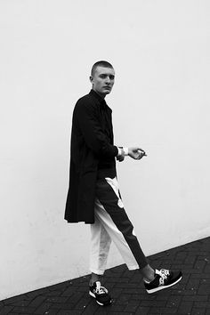 The Inbetween: Magnus Ronning at Premier Models. Photography by Sophie Mayanne. Styling by Kitty Cowell.Magnus wears white jumper by Lagerfeld by Karl Lagerfeld, jumper by John Varantos, shirt by Dioralop, trousers by Chelsea Bravo, trainers by Saucony.Full feature here.