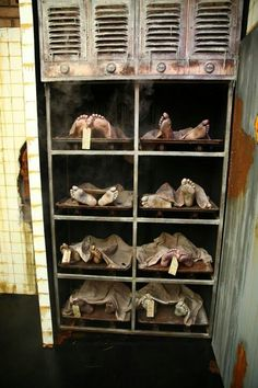 The link is just to an image, but this is totally doable and so delightfully spooky. I'm thinking an old bookshelf or even a refrigerator box would do the trick...