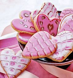Use cranberry juice concentrate and cocoa powder instead of food coloring to make dye free valentine's day red and pink icing for sugar cookies.