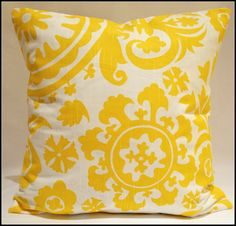 yellow and white pillow