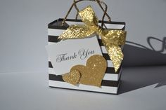 Black and white stripe party favor bag with gold bow by steppnout